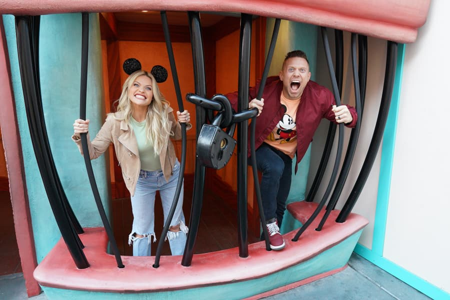 Witney Carson and The Miz take a photo in Toontown at Disneyland park before
