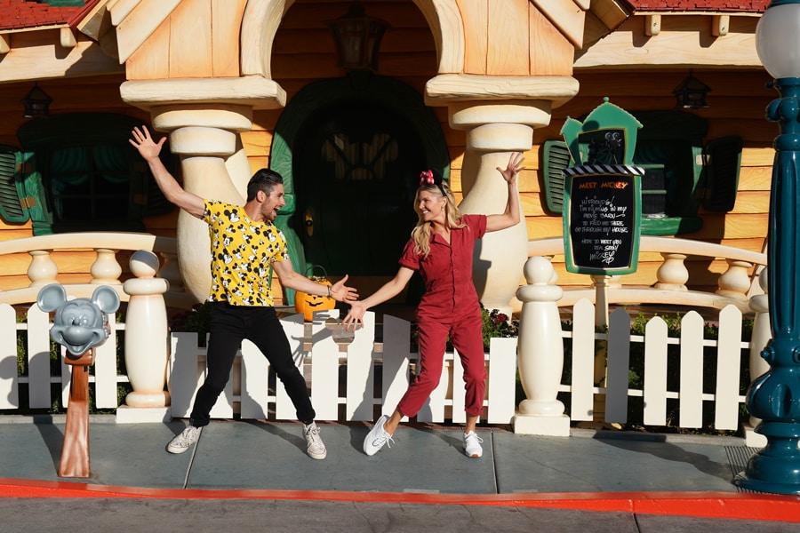 Alan Bersten and Amanda Kloots strike a dancing pose in Toontown at Disneyland park before