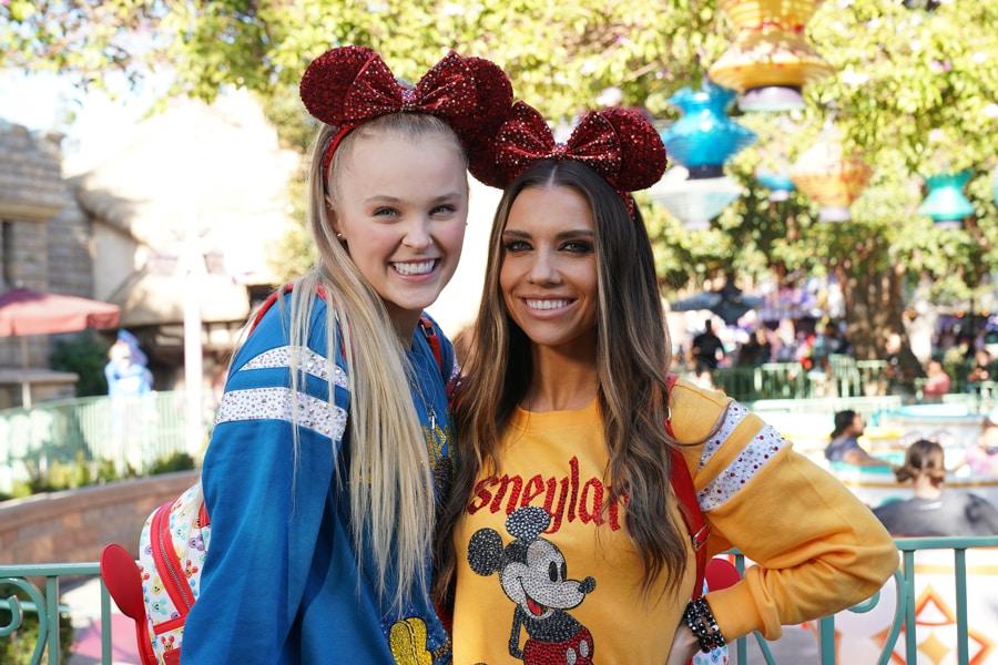 JoJo Siwa and Jenna Johnson pose for a photo at Disneyland park before