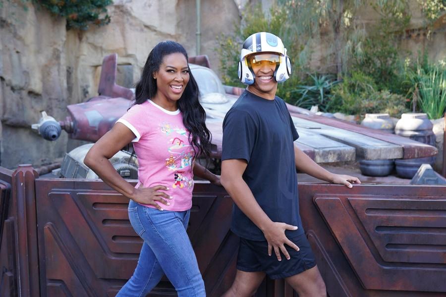 Brandon Armstrong and Kenya Moore take a photo in Star Wars: Galaxy's Edge at Disneyland park before