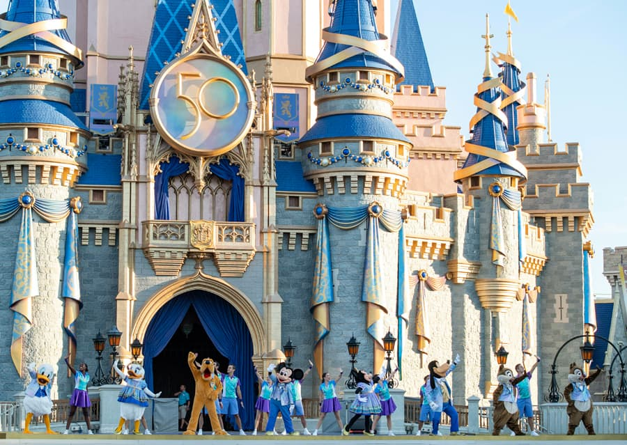 Mickey Mouse, Minnie Mouse and pals welcome guests to Magic Kingdom Park in front of Cinderella Castle, Oct. 1, 2021, on the 50th anniversary of Walt Disney World Resort