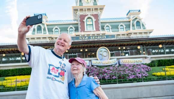 A son celebrates the 50th anniversary of Walt Disney World Resort, Oct. 1, 2021, with his mother, who visited Magic Kingdom Park during its opening year in 1971.