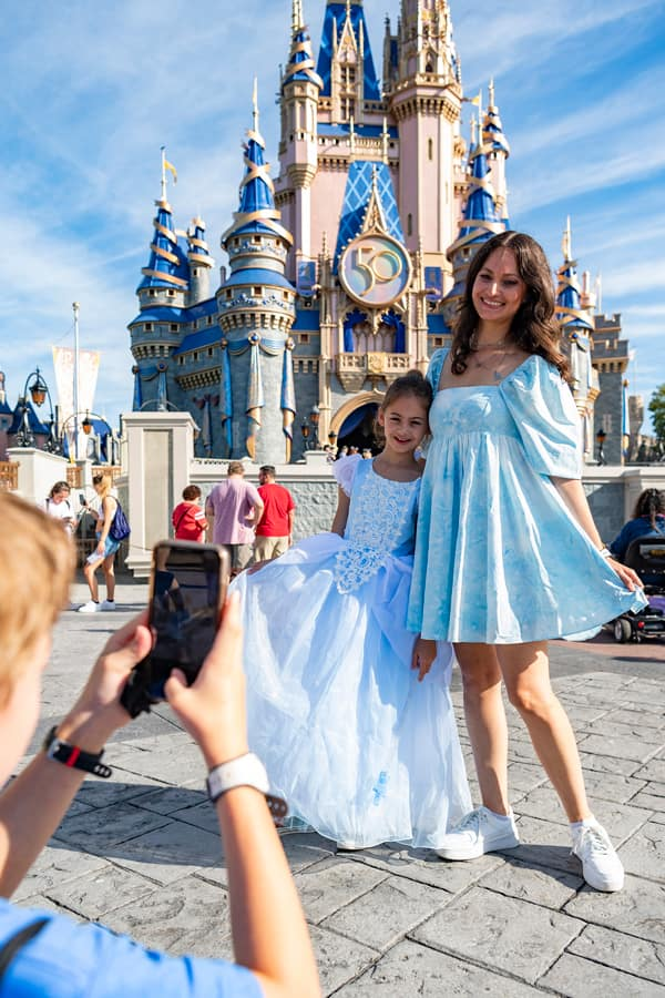 Guests take a photo at Magic Kingdom Park, Oct. 1, 2021, on the 50th anniversary of Walt Disney World Resort