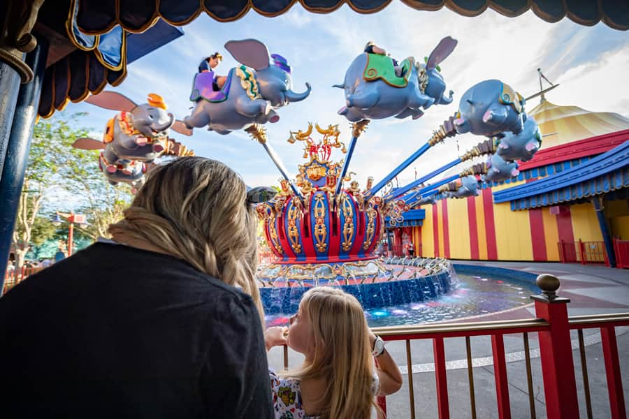 A mother and daughter prepare to experience Dumbo The Flying Elephant at Magic Kingdom Park on Oct. 1, 2021, the 50th anniversary of Walt Disney World Resort