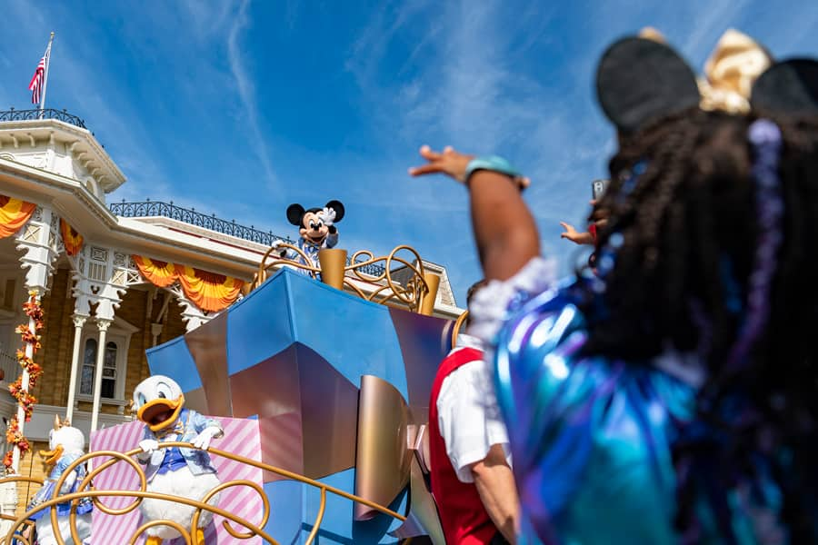 Mickey Mouse waves to a guest at Magic Kingdom Park, Oct. 1, 2021, on the 50th anniversary of Walt Disney World Resort