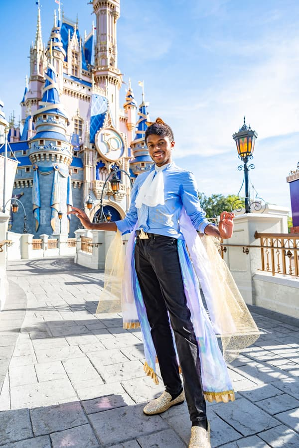 Guests poses for a photo in front of Cinderella Castle at Magic Kingdom Park, Oct. 1, 2021, on the 50th anniversary of Walt Disney World Resort