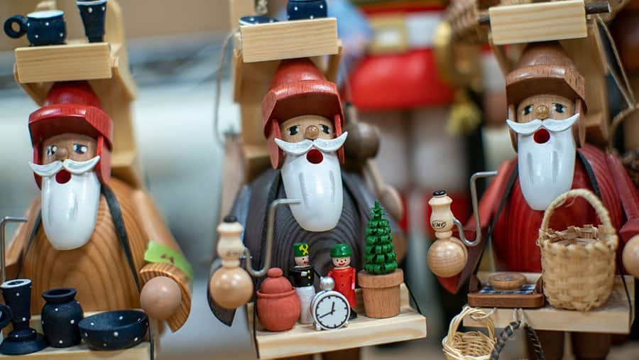 assortment of painted wooden holiday decor