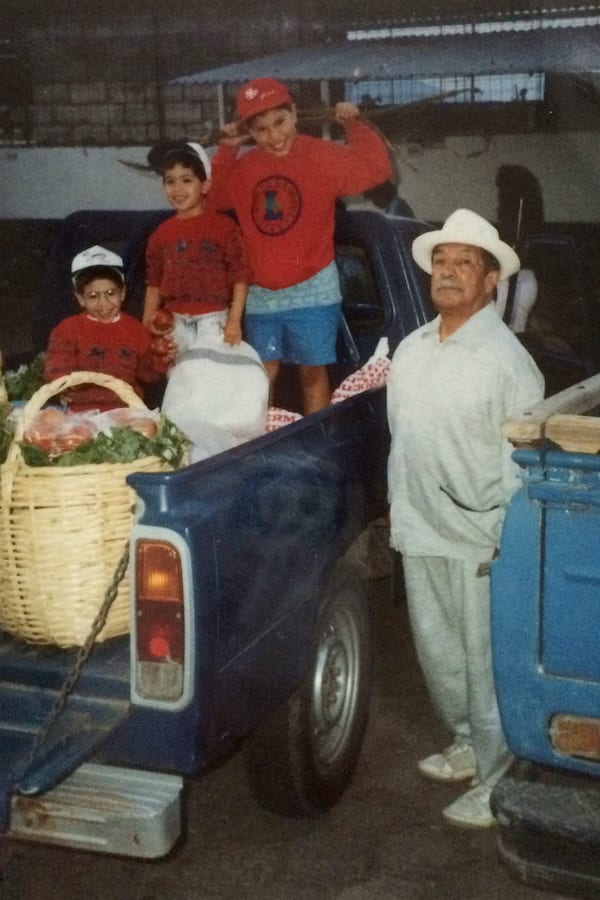 Steve with his younger twin brothers and grandfather, Papa Humbertito, in Ecuador