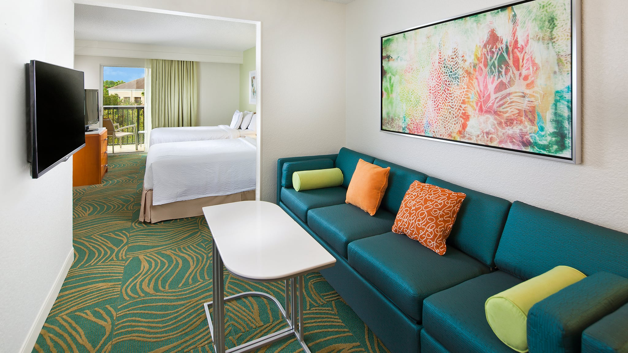 Springhill Suites Orlando Lake Buena Vista In The Marriott Village Fairfield Ct Mount Tv On Wall Home Theater Installation A Sofa With 4 Accent Cushions And 2 Tray Stands Across From Mounted