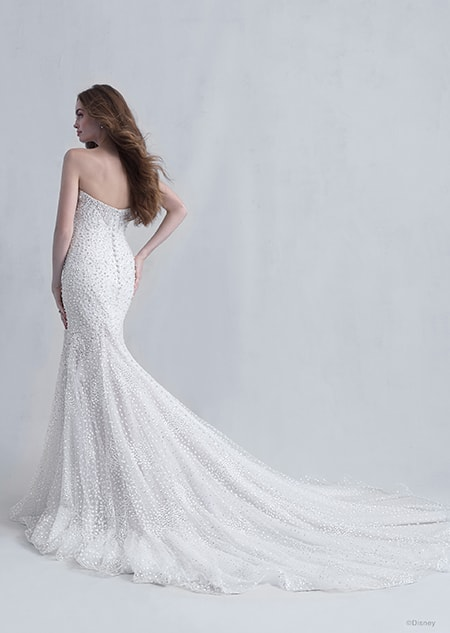 A back side view of a woman wearing the Ariel wedding gown from the 2021 Disney Fairy Tale Weddings Platinum Collection