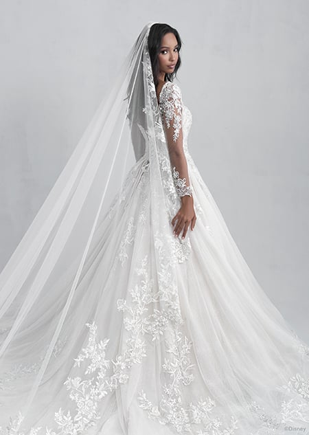 A back side view of a woman wearing the Belle wedding gown from the 2021 Disney Fairy Tale Weddings Platinum Collection
