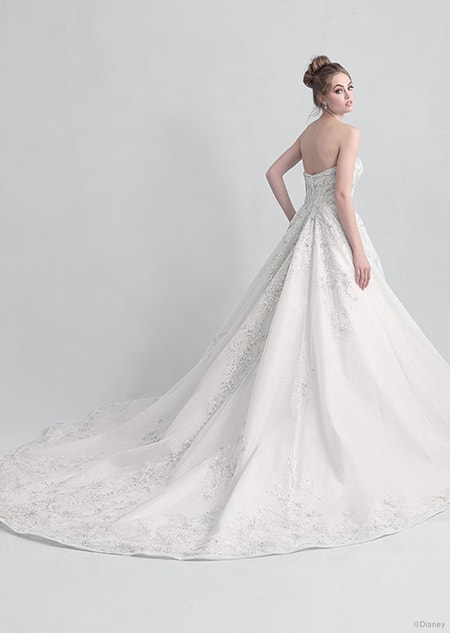 Backside view of a woman wearing the Cinderella wedding gown from the 2021 Disney Fairy Tale Weddings Platinum Collection