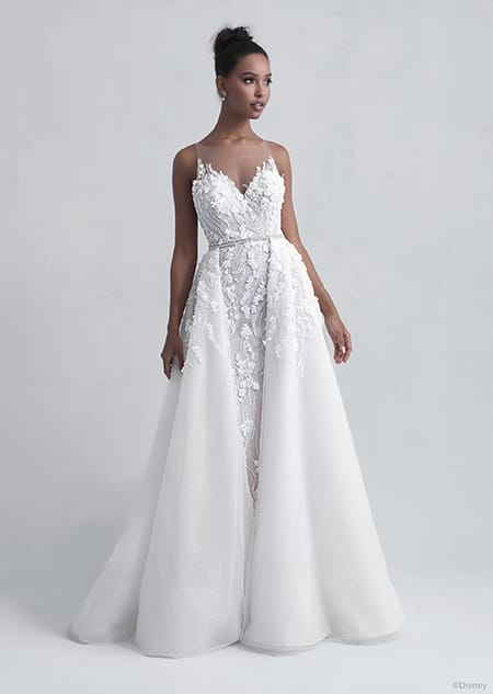 A woman dressed in the Tiana wedding gown from the 2021 Disney Fairy Tale Weddings Platinum Collection