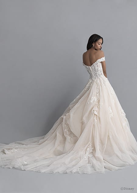 A back side view of a woman wearing the Belle wedding gown from the 2020 Disney Fairy Tale Weddings Platinum Collection
