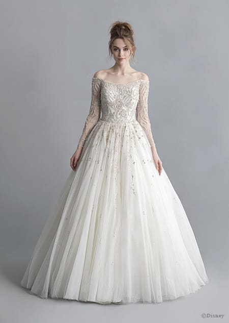 A woman wearing the Cinderella wedding gown from the 2020 Disney Fairy Tale Weddings Platinum Collection
