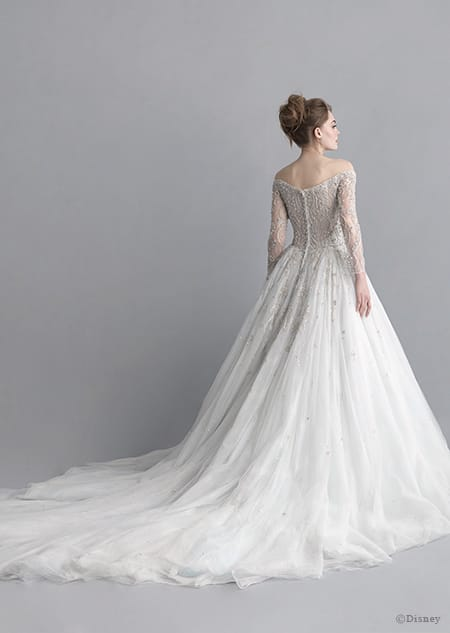 A back side view of a woman wearing the Cinderella wedding gown from the 2020 Disney Fairy Tale Weddings Platinum Collection