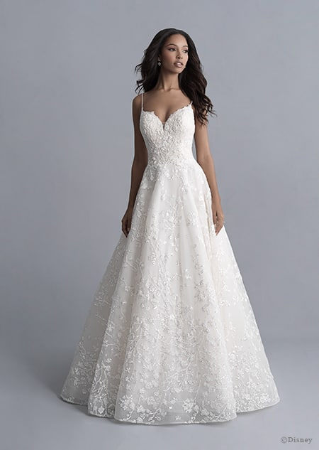 A woman wearing the Tiana wedding gown from the 2020 Disney Fairy Tale Weddings Platinum Collection