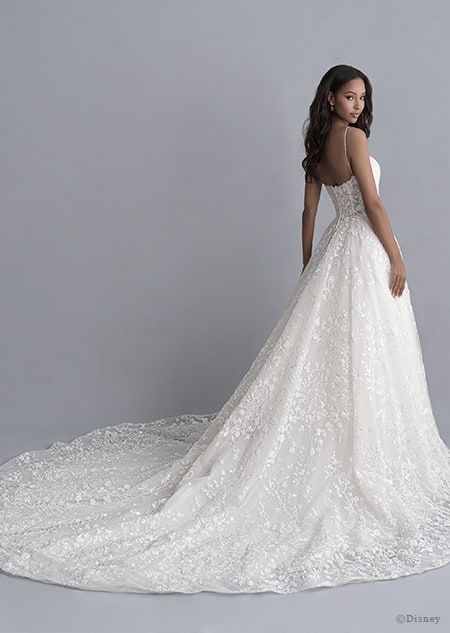 A back side view of a woman in the Tiana wedding gown from the 2020 Disney Fairy Tale Weddings Platinum Collection