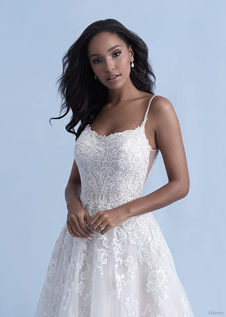 A woman in the Belle wedding gown from the 2021 Disney Fairy Tale Weddings Collection
