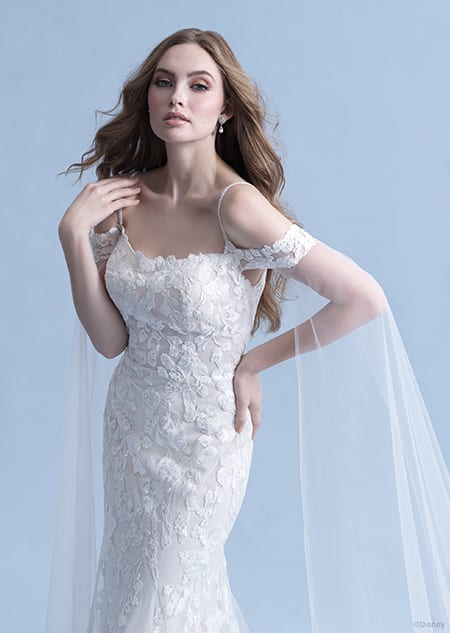 A front side view of a woman wearing the Rapunzel wedding gown from the 2021 Disney Fairy Tale Weddings