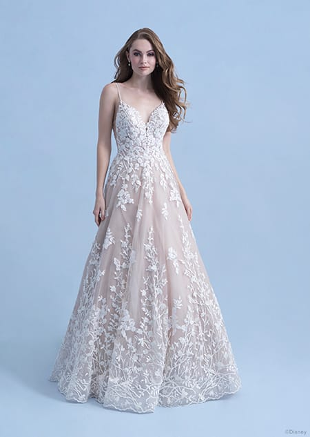 A woman in the Snow White wedding gown from the 2021 Disney Fairy Tale Weddings Collection