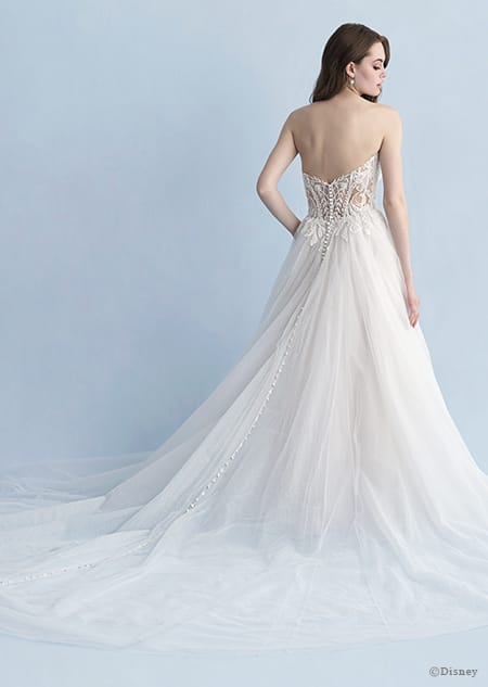 A back side view of a woman in the Aurora wedding gown from the 2020 Disney Fairy Tale Weddings Collection