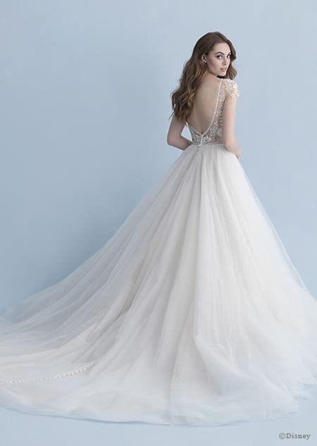 A back side view of a woman wearing the Cinderella wedding gown from the 2020 Disney Fairy Tale Weddings Collection