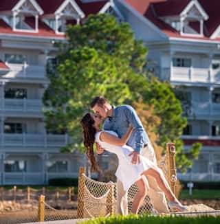 A man and woman embrace and kiss by Disney's Grand Floridian Resort & Spa