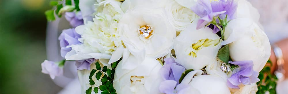 A bouquet of flowers adorned with a crystal charm shaped like Mickey Mouse