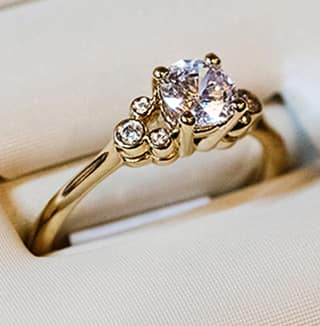 Close up of diamond wedding ring with gold band.