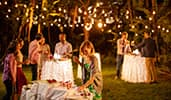 Guests make selections at an outdoor dessert buffet