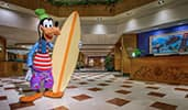 A life size stature of Goofy welcomes Guests to the lobby of Disneys Paradise Pier Hotel