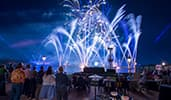 Guests watch an incredible light show over Worlds showcase Lagoon