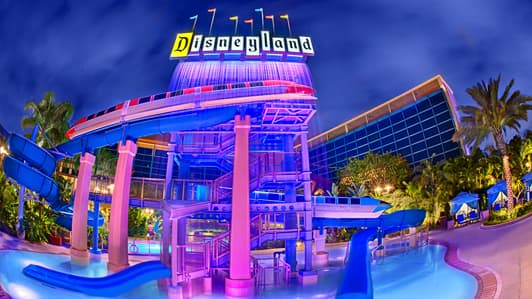 An Outdoor Pool And Waterslide Of Disneyland Hotel At Nighttime