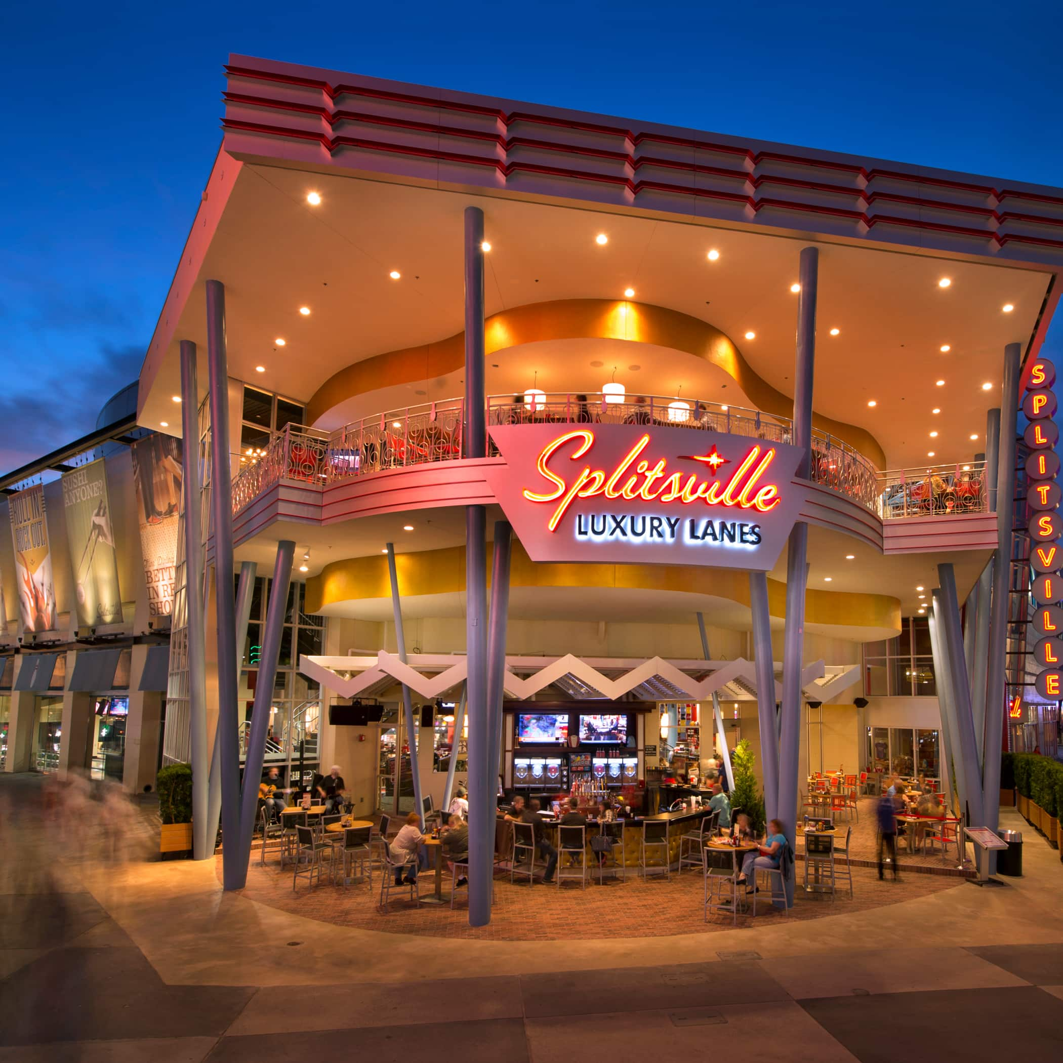 The exterior of Splitsville Luxury Lanes at Disney Springs in Florida, illuminated at night