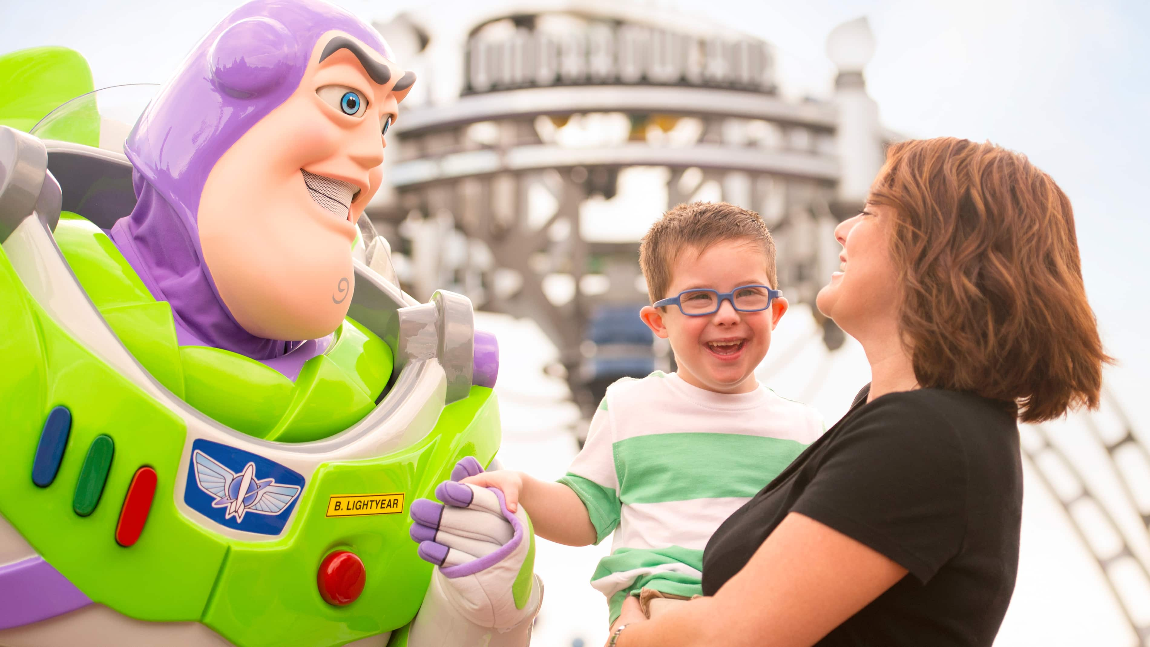 A mother and her son meet Buzz Lightyear