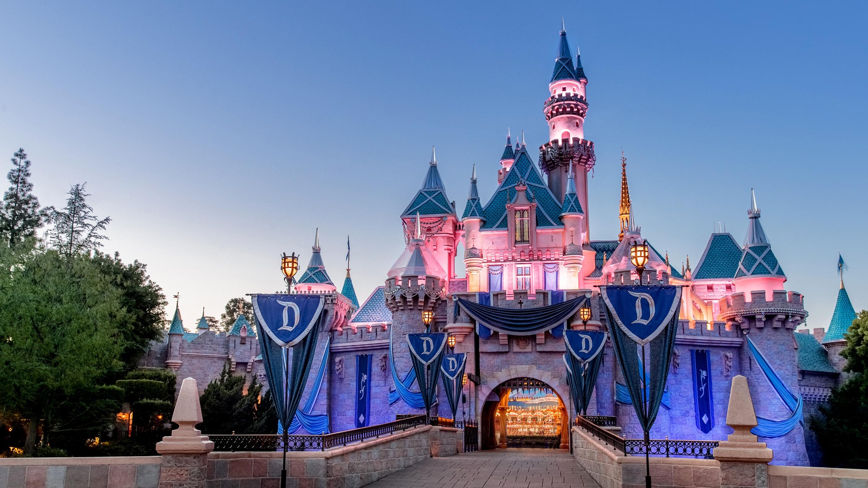 Sleeping Beauty Castle at Disneyland Park, illuminated in the evening