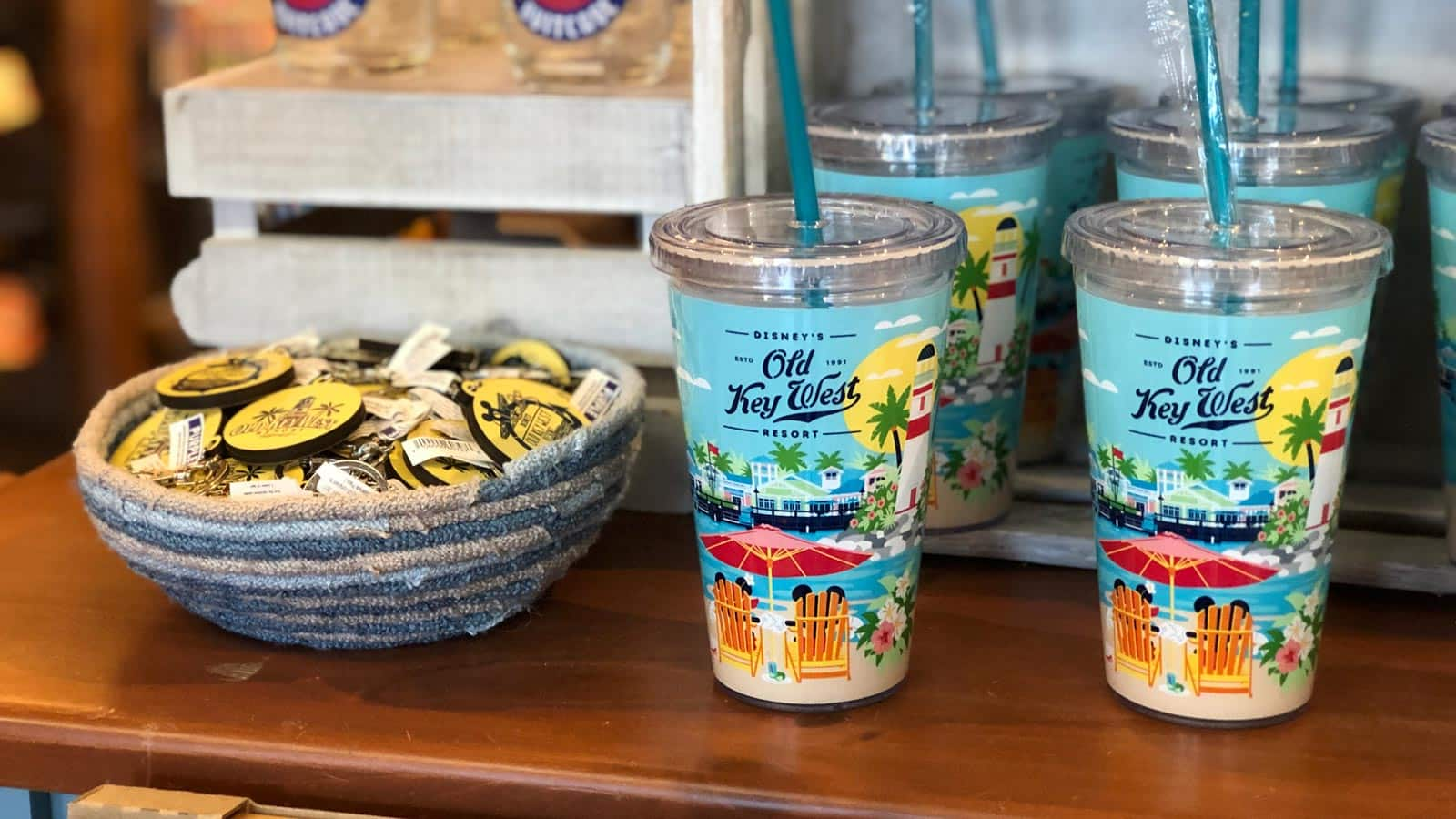 603449f0 Disney's Old Key West Resort tumblers and straws and a bowl full of Resort  key chains