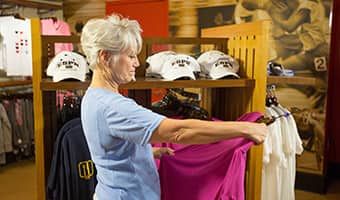 A woman considers buying a shirt inside the ESPN Clubhouse Shop