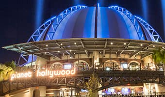 The illuminated exterior of the Planet Hollywood Observatory