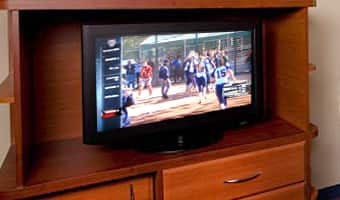 A TV broadcasts an in-house channel featuring highlights from ESPN Wide World of Sports Complex
