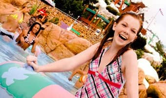 A teenage girl enjoys the water at Melt-Away Bay in Disney's Blizzard Beach water park