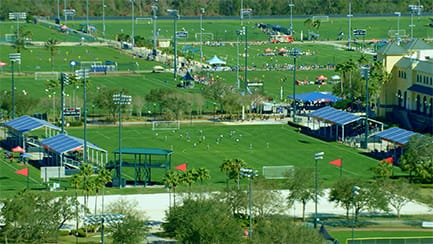 An aerial view of the multi-purpose Marathon Sports Fields hosting soccer matches at ESPN Wide World of Sports Complex