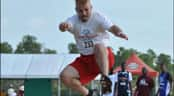 A man practices a long jump