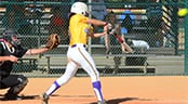 A softball batter warms up in the on-deck circle