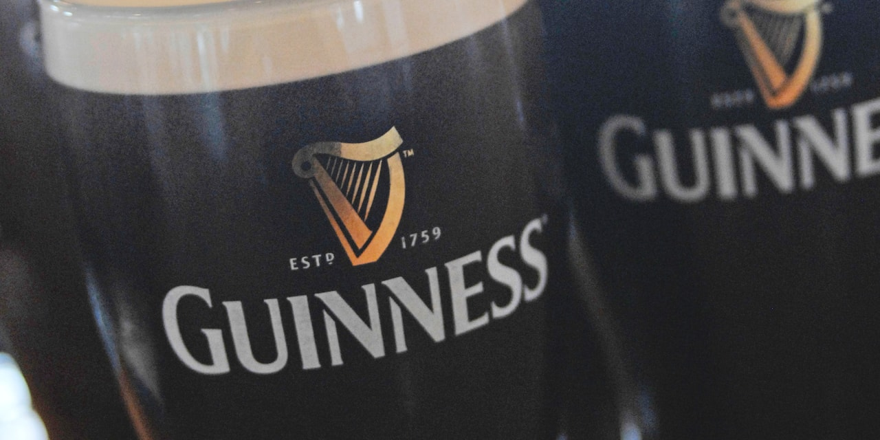A stein filled with dark beer reads 'Guinness, Est. 1759'