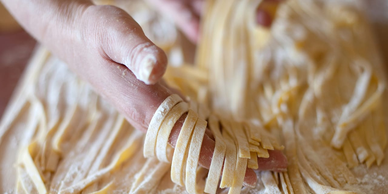 A woman makes pasta from scratch