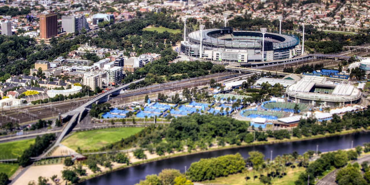 An aerial view of the city of Melbourne with the Melbourne Cricket Ground in the foreground