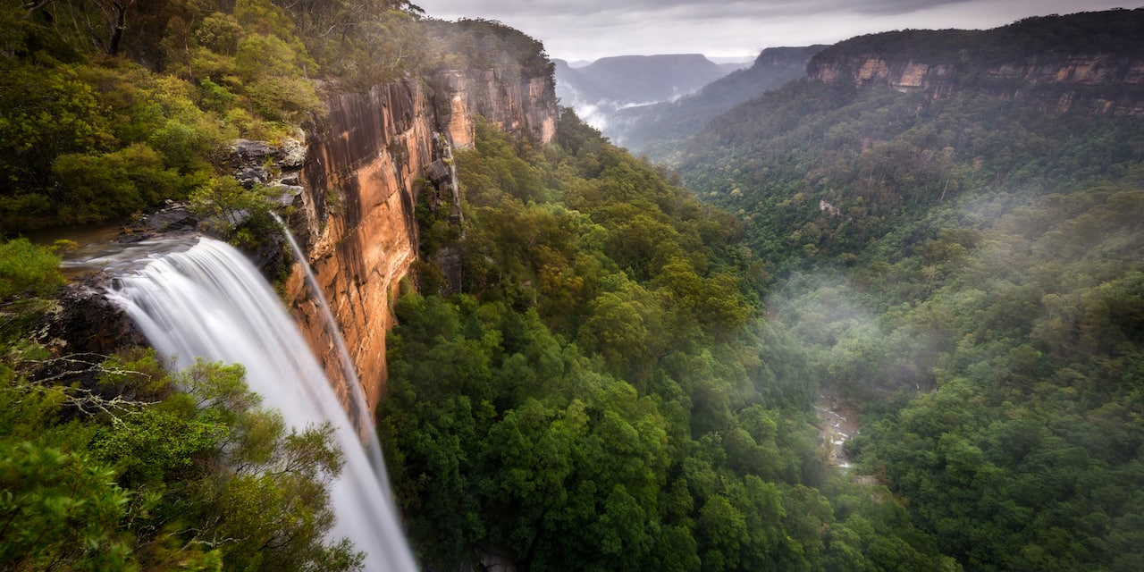 The Fitzroy Falls waterfall with surrounding green bushland