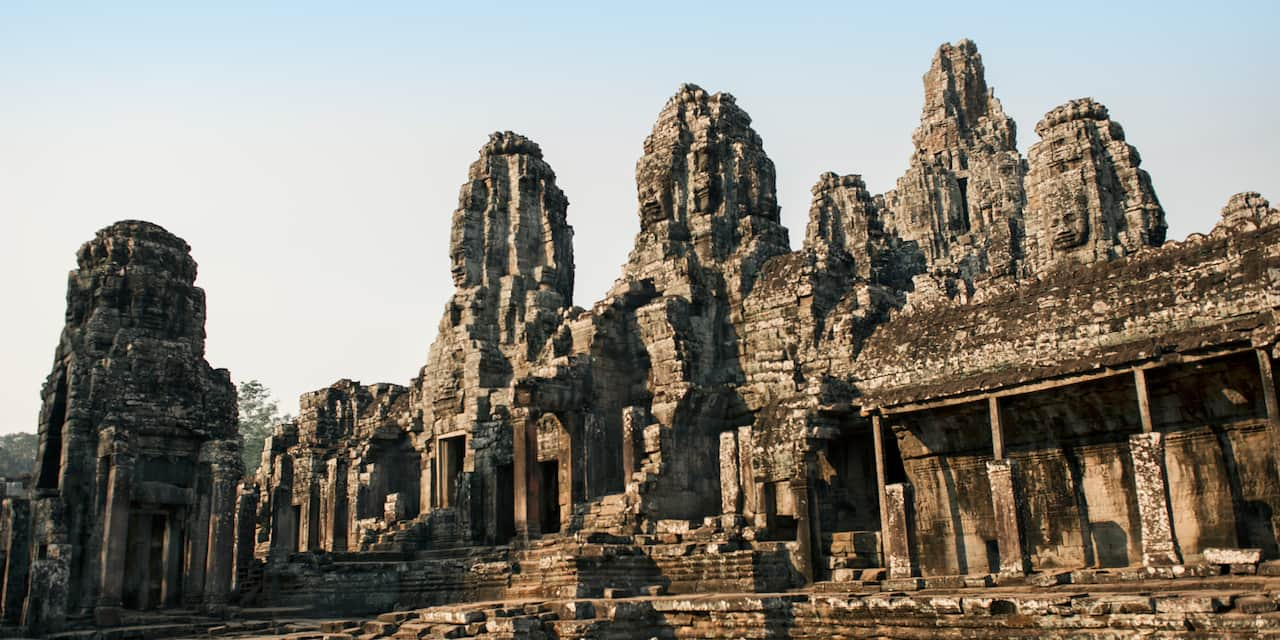 A stone courtyard in front of buildings at the Angkor Wat Archaeological Park